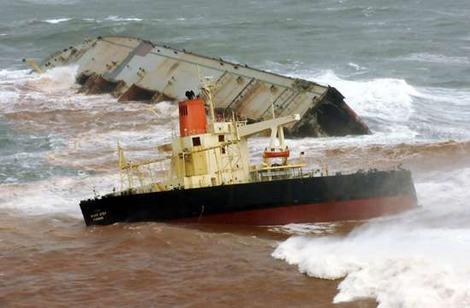 Giant ship runs aground, kills two