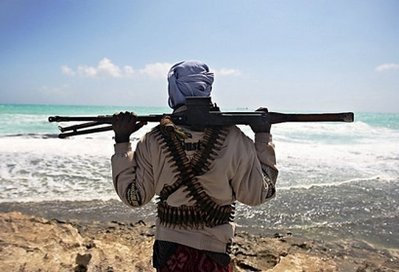 A pirate keeps watch along the coastline at Hobyo town, northeastern Somalia, in January 2010. Pirates …