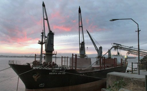 A cargo ship is loaded with wheat in Rosario, Santa Fe province, Argentina. The country's President Cristina Kirchner has accused multinational grain producer Bunge of committing the