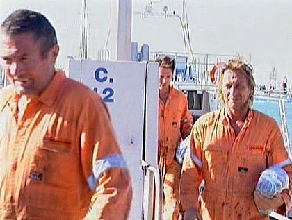The three fishermen arrive ashore after their boat was sunk by a whale. Photo: Channel Ten