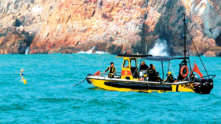2 dead, 6 missing after ships collide off Tung Lung Chau Rescuers search for the missing mainland crewmen after the collision happened off Tung Lung Chau Tuesday afternoon. Provided to China Daily