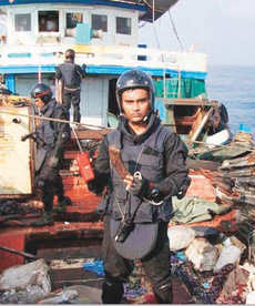 An Indian Navy officer aboard the pirate mother ship that was captured on Sunday.