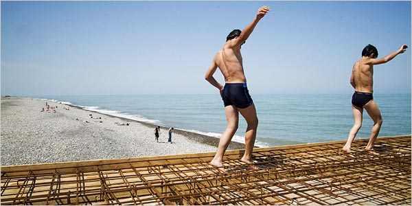 Boys walked last week on a pier under construction in Batumi, Georgia, on the Black Sea. The town is trying to regain its reputation as a resort.