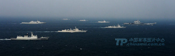 Group sailing: A picture released on Wednesday shows the Liaoning carrier battle group as the nation's first aircraft carrier returns to its home port of Qingdao in Shandong province. (Chinamil.com.cn/Li Jin)