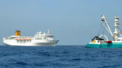 Crippled liner COSTA ALLEGRA supplied by helicopters