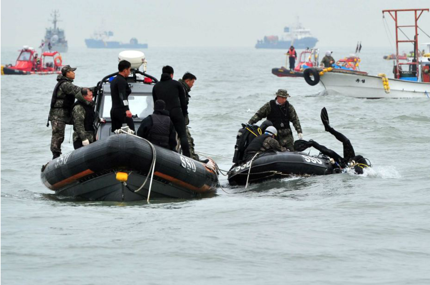 South Korea ferry disaster: Divers remove first bodies from Sewol vessel