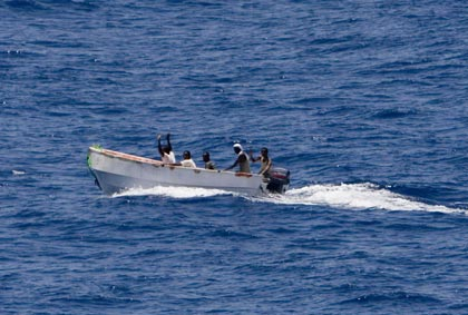 Shipboard guards show weapons, suspected pirate skiff turns tail