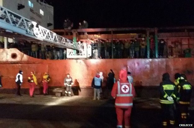 The Blue Sky M docks in Italy with no crew but 700 migrants, four dead