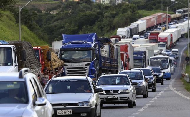 Police reopen Santos port, but Brazil's striking truckers block roads