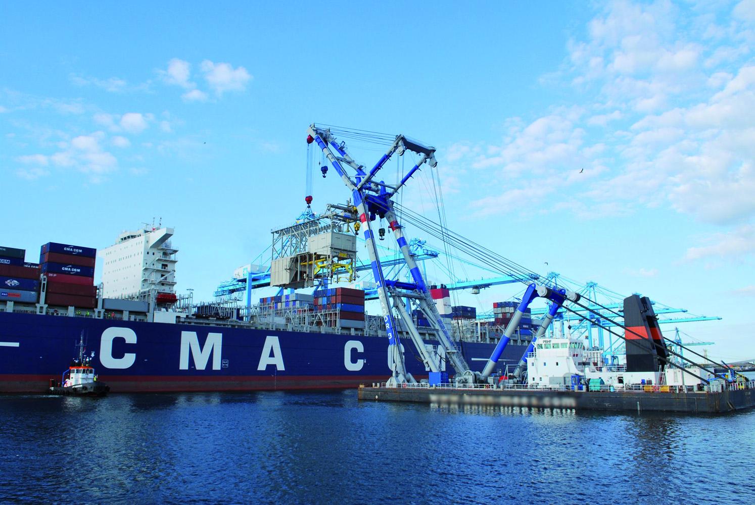 Mega ships get fatter but not much longer, limiting cranes alongside