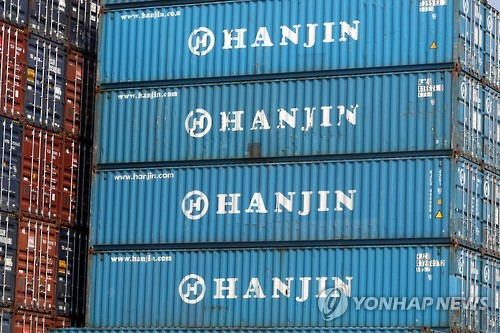 HIT says it faces extra costs, denies gouging in HK to free Hanjin boxes