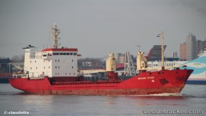 Listing cargo ship righted