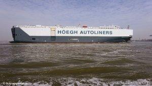 Vehicles carrier adrift in storm
