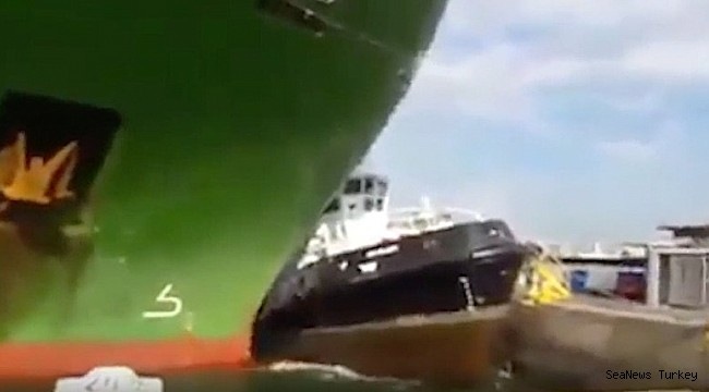 Tug sandwiched by car carrier