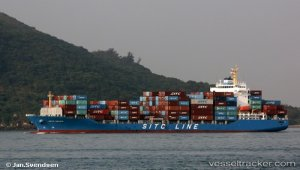 Container ship evacuated after fire