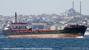 Disabled freighter under tow to Thessaloniki