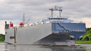 Damaged car carrier under tow to Gdynia