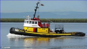 Tug to be raised by crane barge