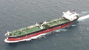 Tanker Saves Two People Clinging to Board in the Ocean!
